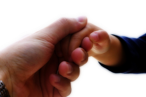 Photo of a parent holding a child's hand by  Jonathan Cohen on flickr. License:  Attribution-NonCommercial 2.0 Generic (CC BY-NC 2.0)